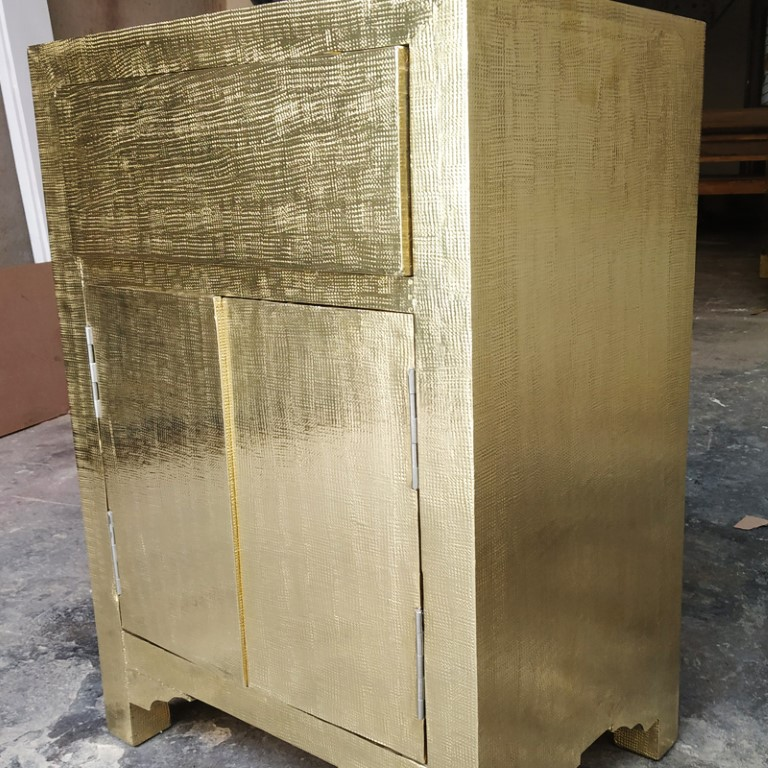 Brass cladding on bedside